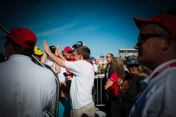 Nicholas and his sister Morgan celebrate after high-fiving Jeff Gordon! (Photo Cred: Themba Imagery)
